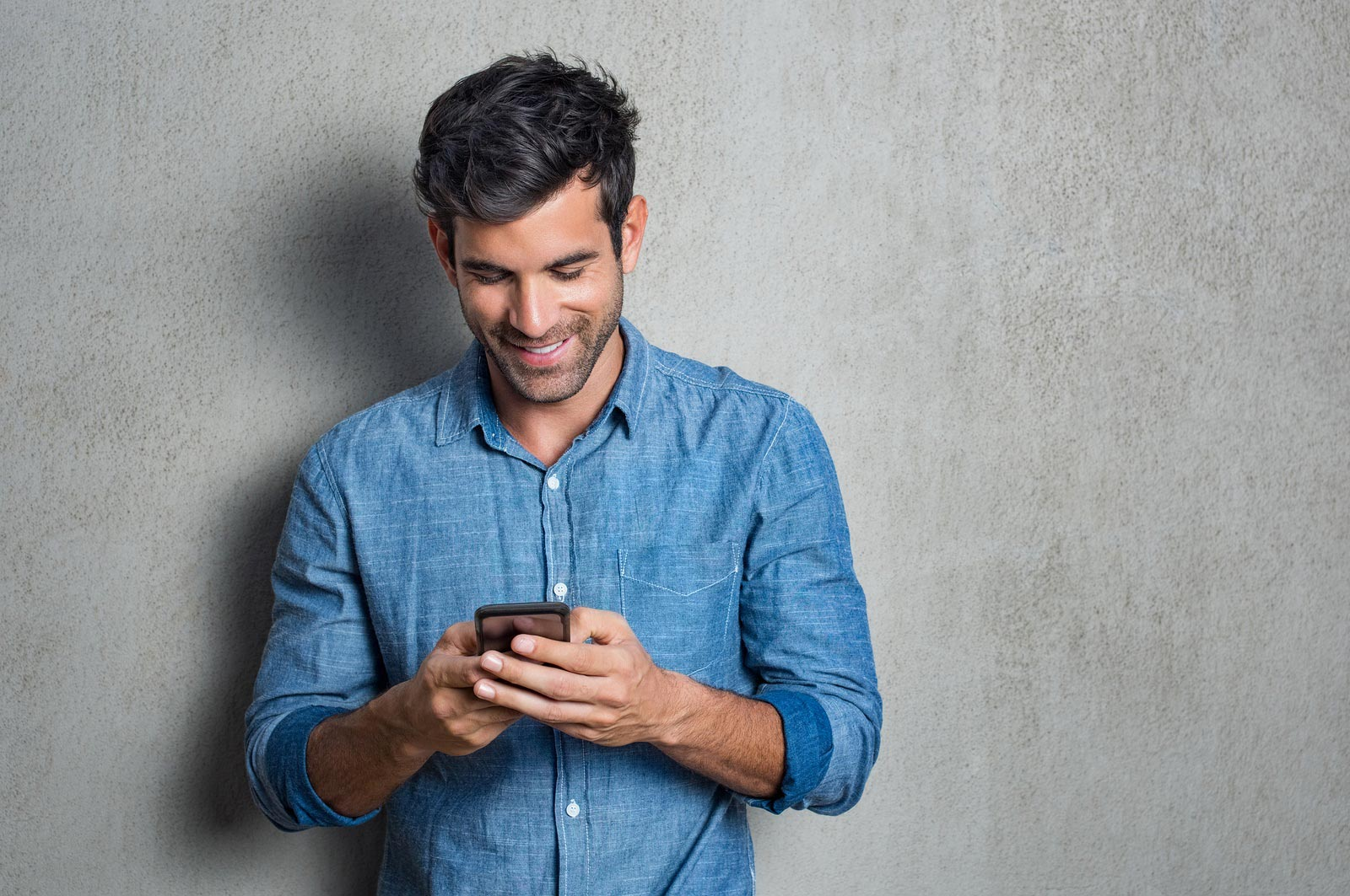 bigstock-Young-man-texting-message-on-s-203276239-1
